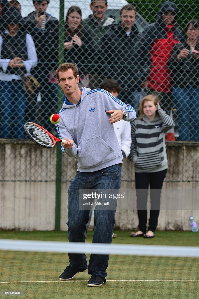 Tennis player <a gi-track='captionPersonalityLinkClicked' href=/galleries/search?phrase=Andy+Murray+-+Tennisser&family=editorial&specificpeople=200668 ng-click='$event.stopPropagation()'>Andy Murray</a> meets fans during a visit to Dunblane Sports Club, where he started playing tennis as a child, after he returned to Dunblane following his win in the US Open and his gold medal in the 2012 Olympic games in London, on September 16, 2012 in Dunblane, Scotland. Thousands lined the streets of his hometown as the 25 year old returned to meet with family and friends following his summer triumphs.