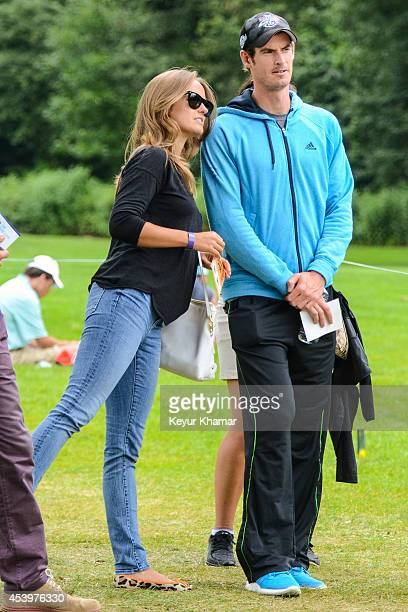 Tennis player Andy Murray of Great Britain and his girlfriend Kim Sears watch play on the third hole during the second round of The Barclays at...