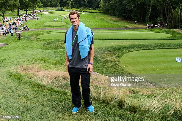 Tennis player Andy Murray of Great Britain poses on the eighth hole green during the second round of The Barclays at Ridgewood Country Club on August...