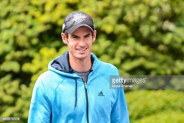Tennis player Andy Murray of Great Britain smiles as he arrives to watch play during the second round of The Barclays at Ridgewood Country Club on...