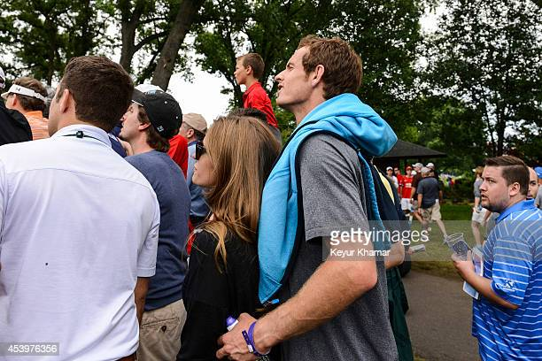 Tennis player Andy Murray of Great Britain tries to get a better view as he watches play on the sixth hole during the second round of The Barclays at...