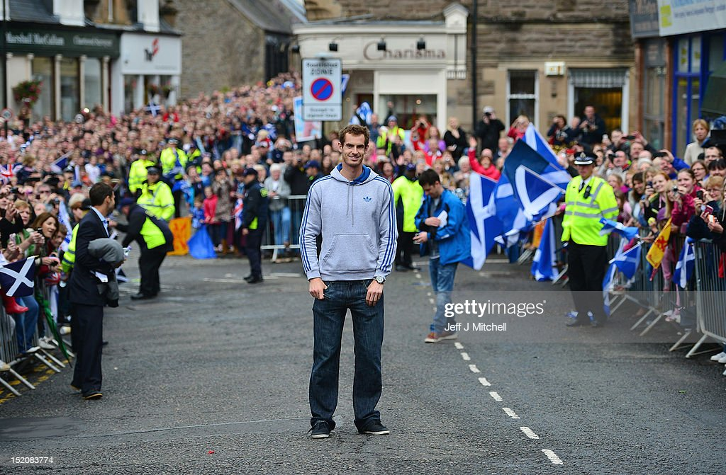 Tennis player Andy Murray returns to Dunblane following his win in the US Open and his gold medal in the 2012 Olympic games in London, on September 16, 2012 in Dunblane, Scotland. Thousands lined the streets of his hometown as the 25 year old returned to meet with family and friends following his summer triumphs.