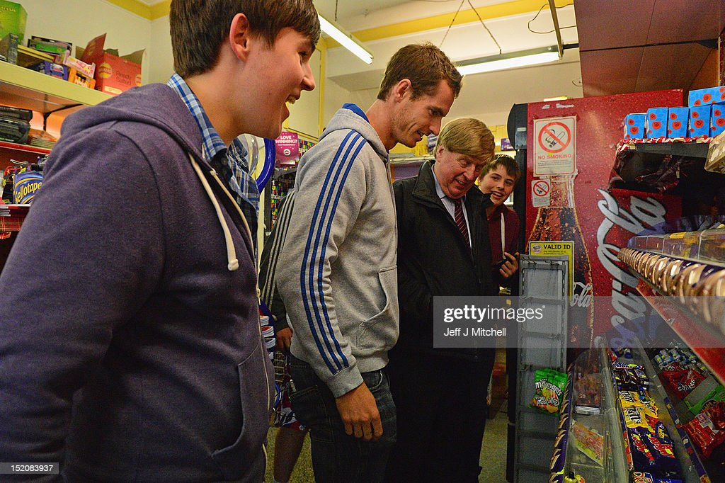 Tennis player Andy Murray visits a newsagents after he returned to Dunblane following his win in the US Open and his gold medal in the 2012 Olympic games in London, on September 16, 2012 in Dunblane, Scotland. Thousands lined the streets of his hometown as the 25 year old returned to meet with family and friends following his summer triumphs.