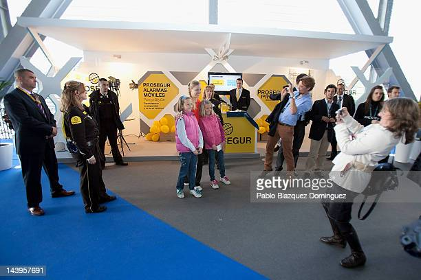 Tennis player Angelique Kerber of Germany takes pictures with fans at the Prosegur stand during the second day of the WTA Mutua Madrilena Madrid Open...
