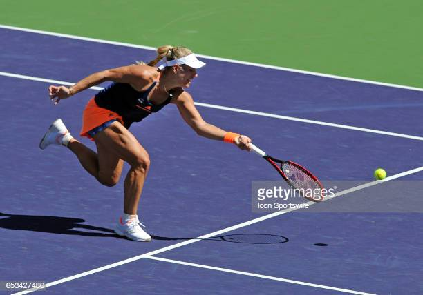 Tennis player Angelique Kerber runs towards the net to return a shot in the second set of a match against Pauline Parmentier played on March 13 2017...
