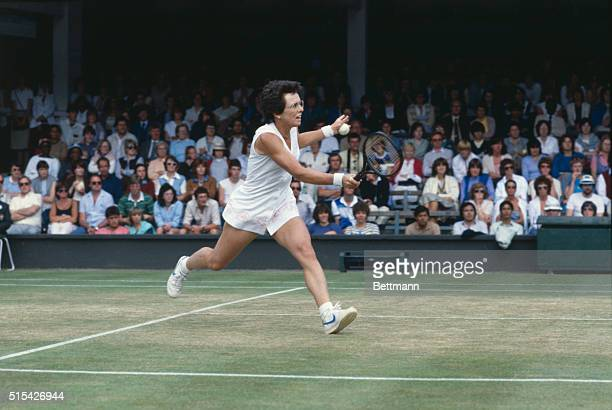Tennis player Billie Jean King serves during a match against Kathy Jordan during the Wimbledon Tennis Tournament