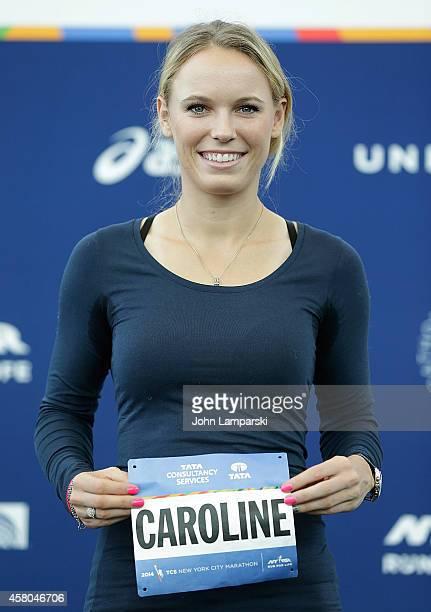 Tennis player Caroline Wozniacki picks up her New York City Marathon Official Race Bib at The Jacob K Javits Convention Center on October 29 2014 in...
