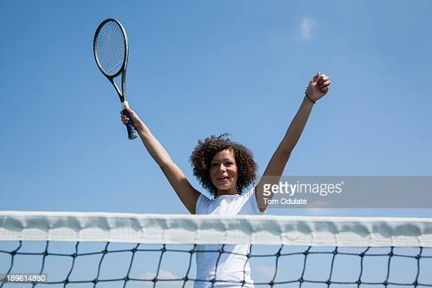 Tennis player cheering on court