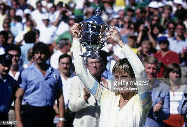 Tennis player Chris Evert Lloyd of the USA hold the trophy above her head after defeating Hana Mandlikova 576161 during the women finals of the 1980...