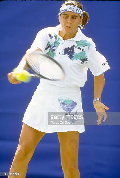 Tennis player Conchita Martinez of the Spain returns a shot during the women 1994 US Open Tennis Tournament at the USTA National Tennis Center in the...