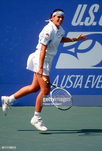 Tennis player Conchita Martinez of the Spain returns a shot during the women 1995 US Open Tennis Tournament at the USTA National Tennis Center in the...