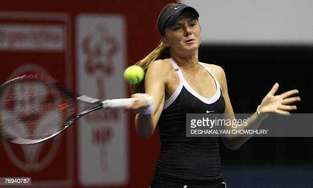 Tennis player Daniela Hantuchova of Slovakia plays a shot to Yung Jan Chan of Taipei during a quarter final round match of the Sunfeast Open 2007 a...