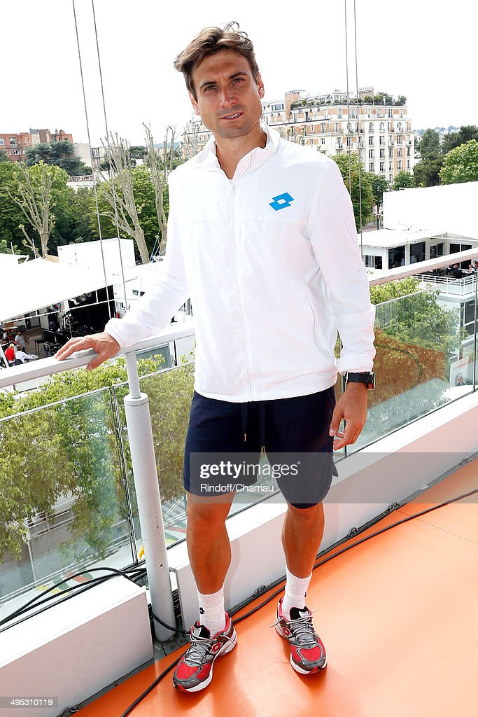 Tennis player <a gi-track='captionPersonalityLinkClicked' href=/galleries/search?phrase=David+Ferrer&family=editorial&specificpeople=208197 ng-click='$event.stopPropagation()'>David Ferrer</a> poses at France Television french chanels studio whyle the Roland Garros French Tennis Open 2014 - Day 9 on June 2, 2014 in Paris, France.