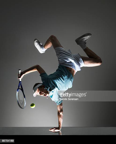 Tennis Player doing a one hand handstand