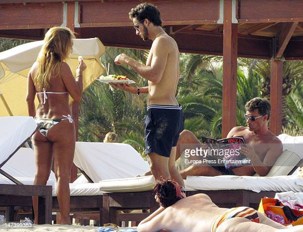 Tennis player Feliciano Lopez and ex football player Michel are seen on the beach on June 29 2012 in Ibiza Spain