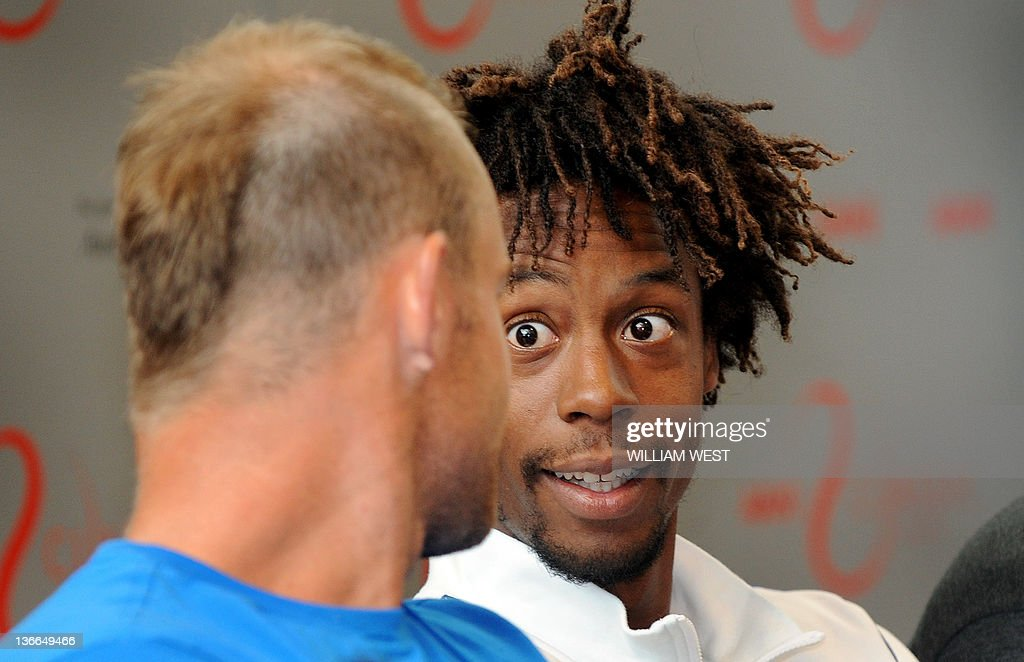 Tennis player Gael Monfils of France speaks with Andy Roddick of the US during a press conference for the upcoming Kooyong Classic in Melbourne on...