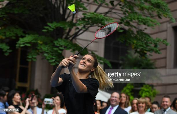 Tennis player Genie Bouchard of Canada plays Nick Kyrgioas of Australia in the Lotte New York Palace Invitational Badminton Tournament at the Lotte...