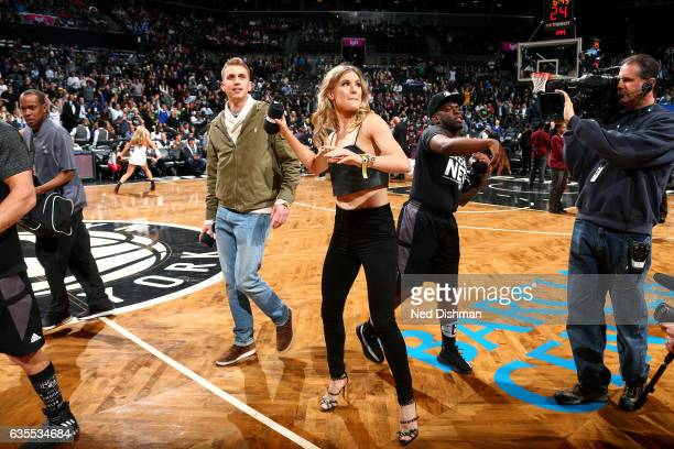 Tennis player Genie Bouchard throws a shirt out into the crowd during the game between the Brooklyn Nets and the Milwaukee Bucks on February 15 2017...