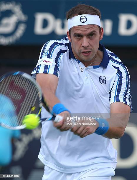 Tennis player Gilles Muller of Luxembourg returns the ball to Andy Murray of Great Britain during their match in the second day of the ATP Dubai Duty...