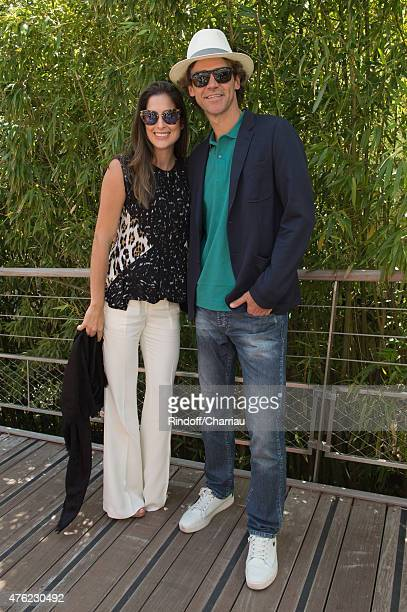 Tennis Player Gustavo Kuerten and his wife Mariana Soncini attend the Men Final of 2015 Roland Garros French Tennis Open Day Fithteen on June 7 2015...