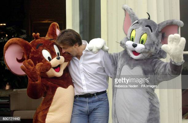 Tennis player Henri Leconte with Tom and Jerry before the start of the Tim Henman Celebrity Golf Tournament at Stoke Park Club Buckinghamshire