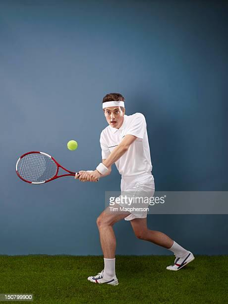 A tennis player hitting a ball