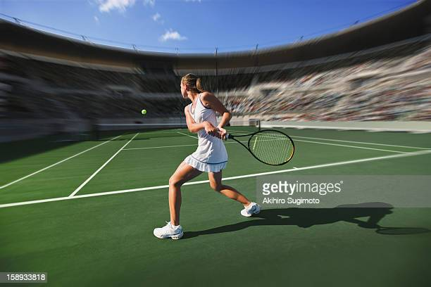 Tennis player hitting backhand return