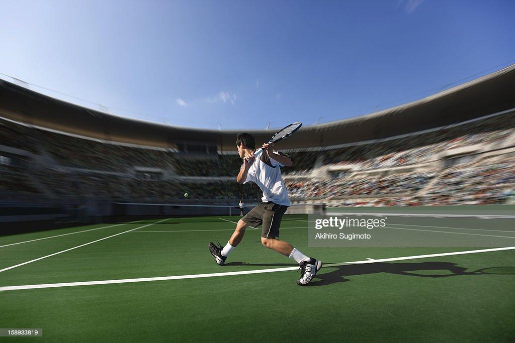 Tennis player hitting backhand return