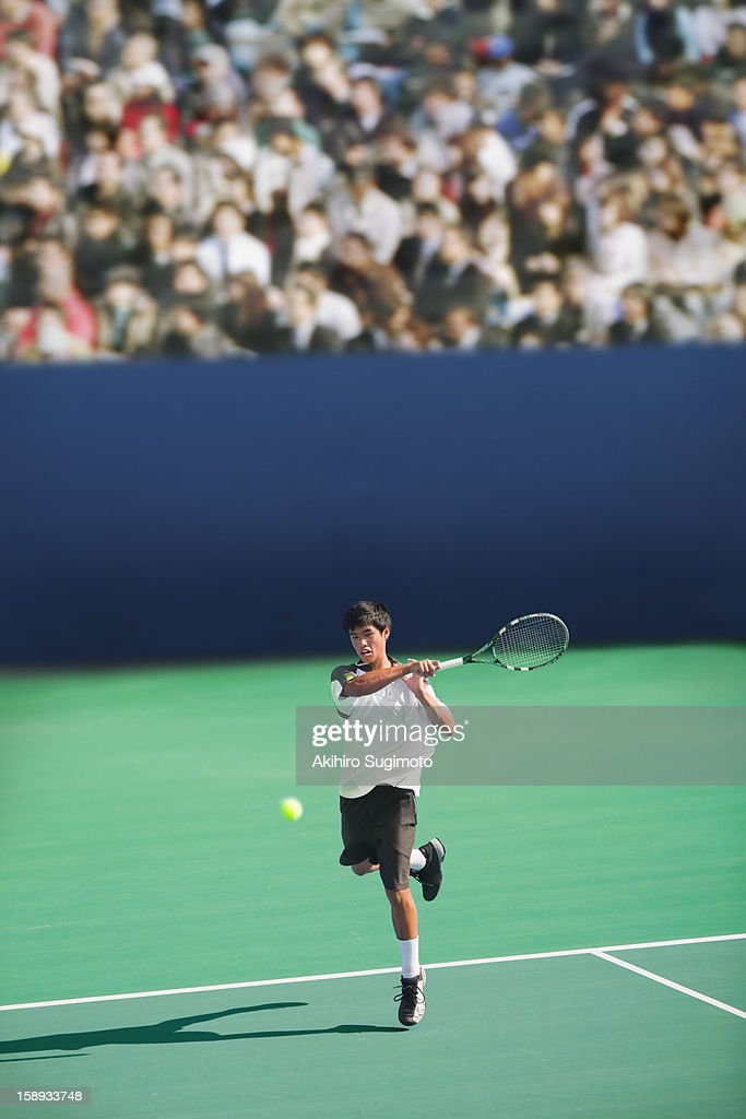 Tennis player hitting forehand return