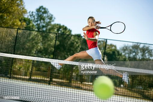 Tennis player hitting forehand winner
