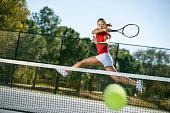 Tennis player hitting forehand winner