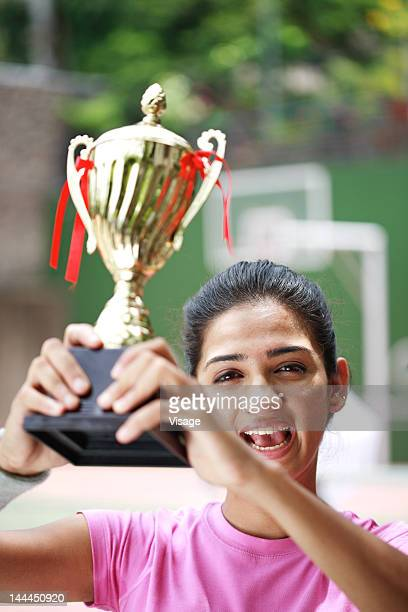 Tennis player holding her trophy