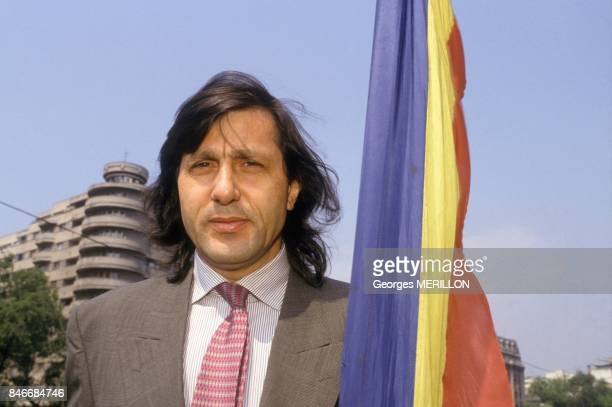 Tennis player Ilie Nastase holding Romanian flag on April 26 1990 in Bucharest Romania