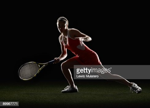 Tennis player in receiving position : Stock Photo