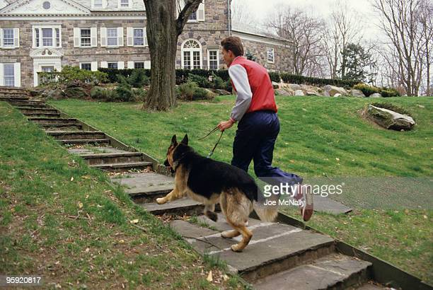 Tennis player Ivan Lendl a 26 year old Czechoslovakian runs up the steps on the grounds of his Greenwich CT mansion alongside his German Shepherd...