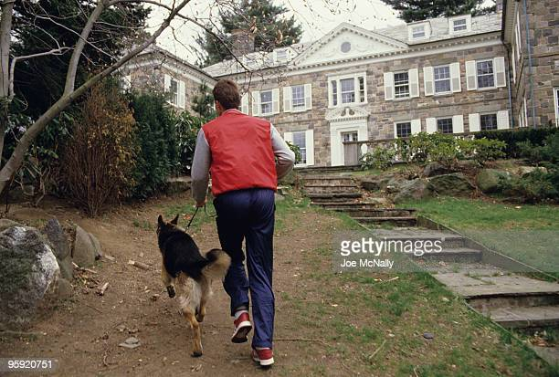 Tennis player Ivan Lendl a 26 year old Czechoslovakian takes his German Shepherd Viky for a walk around the groundds of his Greenwich CT estate April...