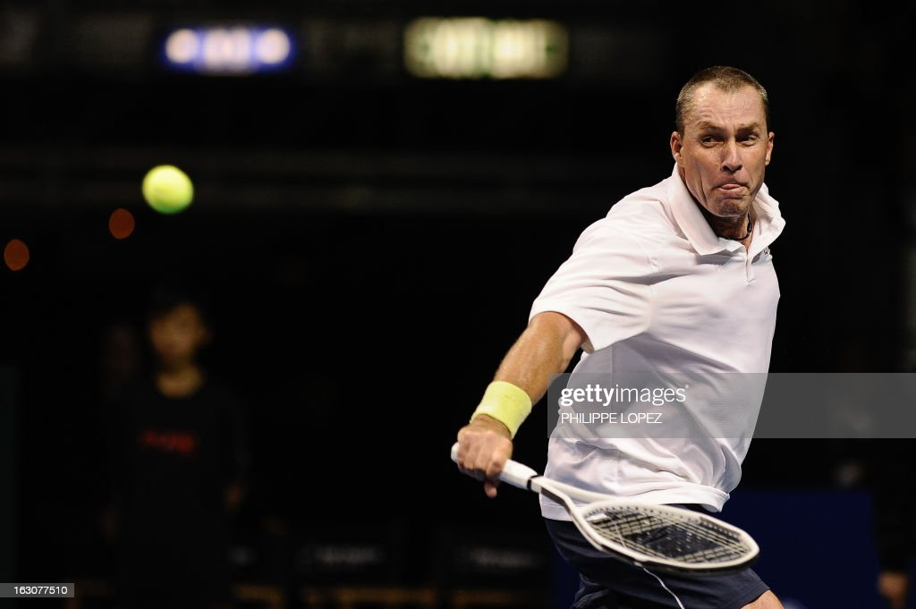 US tennis player Ivan Lendl eyes the ball during an exhibition match against his compatriot John McEnroe at the BNP Paribas Showdown in Hong Kong on March 4, 2013. McEnroe won 8-5. AFP PHOTO / Philippe Lopez