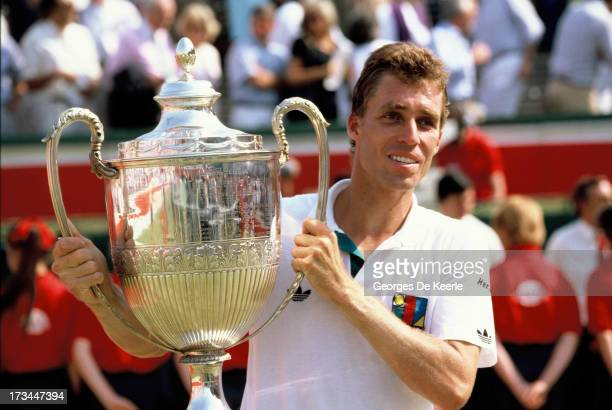 Tennis player Ivan Lendl rises his trophy after winning the Stella Artois Championships held at the Queen's Club on June 18 1989 in London England