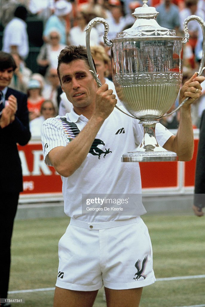Tennis player Ivan Lendl rises the trophy of the Stella Artois Championships held at the Queen's Club after winning the final match against Boris Becker on June 17, 1990 in London, England.