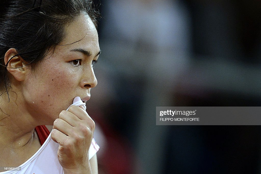 US tennis player Jamie Hapton reacts during her Fed Cup tennis match against Italy's Roberta Vinci in Rimini's 105 Stadium on February 10, 2013.Vinci won 6-2, 4-6 ,6-1.