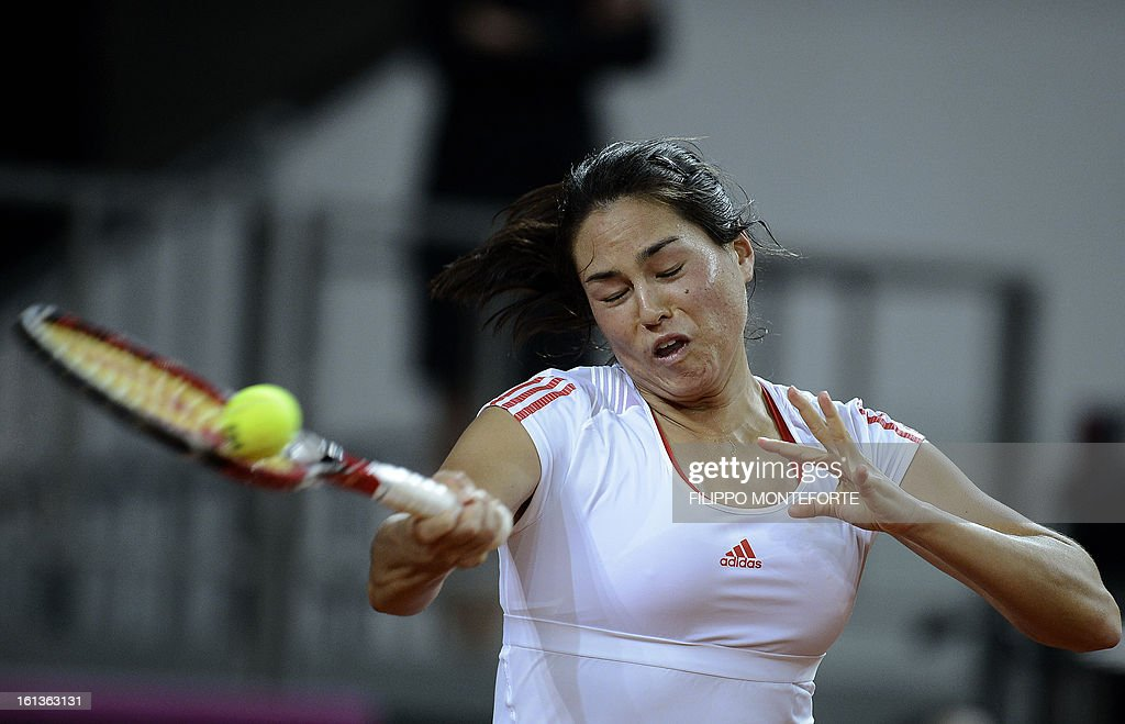 US tennis player Jamie Hapton returns a ball to Italy's Roberta Vinci during their Fed Cup tennis match in Rimini's 105 Stadium on February 10, 2013.Vinci won 6-2, 4-6, 6-1.