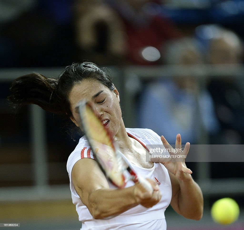 US tennis player Jamie Hapton returns a ball to Italy's Roberta Vinci during their Fed Cup tennis match in Rimini's 105 Stadium on February 10, 2013.Vinci won 6-2, 4-6, 6-1 .