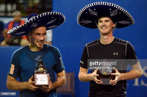 UK tennis player Jamie Murray and Brazilian tennis player Bruno Soares pose with their trophies after winning the Mexican Tennis Open doubles final...