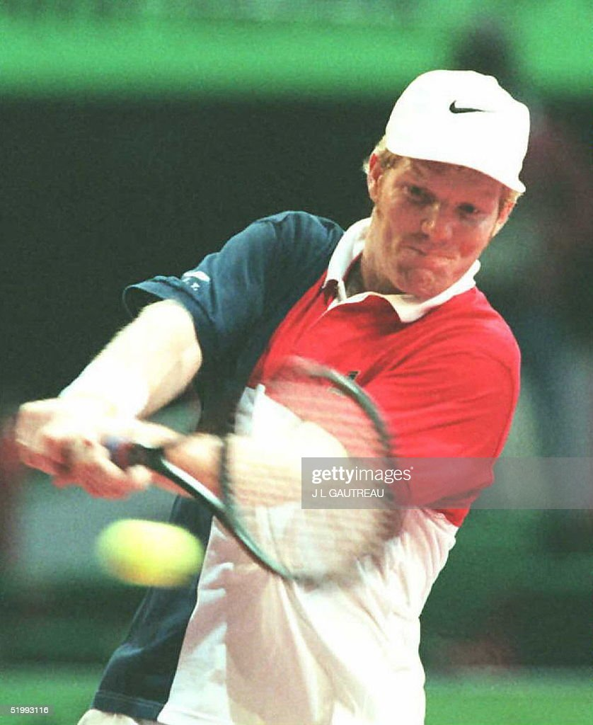 US tennis player Jim Courier hits a two handed bac