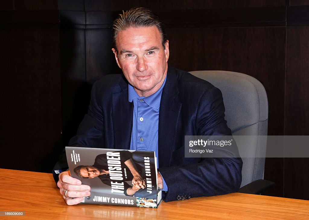 Tennis player <a gi-track='captionPersonalityLinkClicked' href=/galleries/search?phrase=Jimmy+Connors&family=editorial&specificpeople=157507 ng-click='$event.stopPropagation()'>Jimmy Connors</a> signs copies of his book 'The Outsider' at Barnes & Noble bookstore at The Grove on May 22, 2013 in Los Angeles, California.