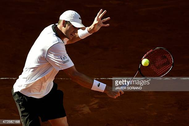 US tennis player John Isner returns a ball to Czech tennis player Tomas Berdych during the men quarterfinals of Madrid Open tournament at the Caja...