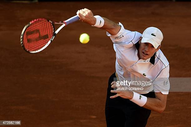 US tennis player John Isner serves to Czech tennis player Tomas Berdych during the men quarterfinals of Madrid Open tournament at the Caja Magica...