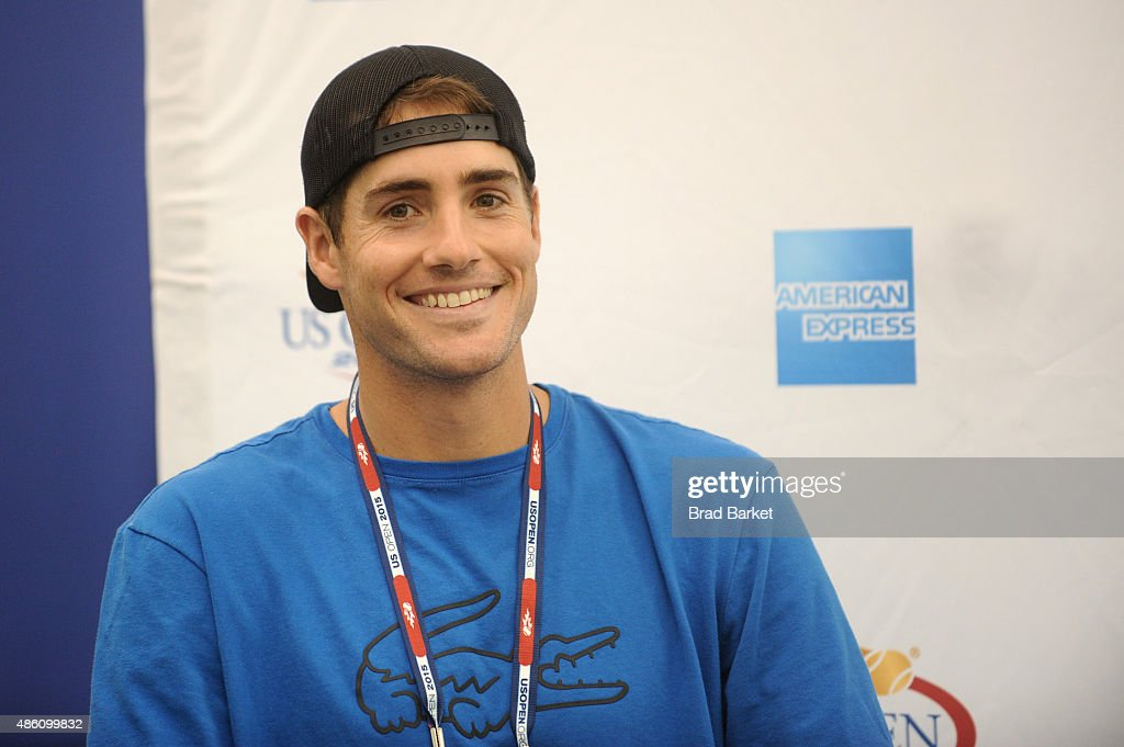 Tennis player <a gi-track='captionPersonalityLinkClicked' href=/galleries/search?phrase=John+Isner+-+Tennis+Player&family=editorial&specificpeople=4439464 ng-click='$event.stopPropagation()'>John Isner</a> speaks at The American Express Fan Experience at The 2015 US Open featuring 'You Vs. Sharapova' Virtual Reality Experience and American Express Fan Court at USTA Billie Jean King National Tennis Center on August 31, 2015 in New York City.