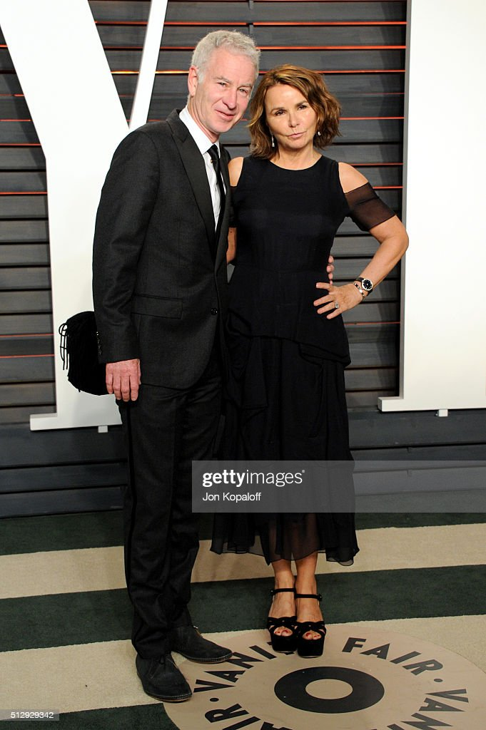 Tennis player John McEnroe and singer-songwriter Patti Smyth attend the 2016 Vanity Fair Oscar Party hosted By Graydon Carter at Wallis Annenberg Center for the Performing Arts on February 28, 2016 in Beverly Hills, California.
