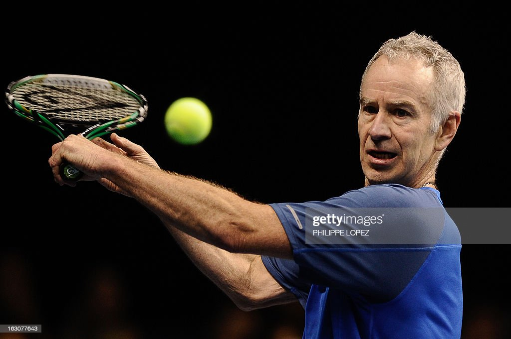 US tennis player John McEnroe eyes the ball during an exhibition match against his compatriot Ivan Lendl at the BNP Paribas Showdown in Hong Kong on March 4, 2013. McEnroe won 8-5. AFP PHOTO / Philippe Lopez